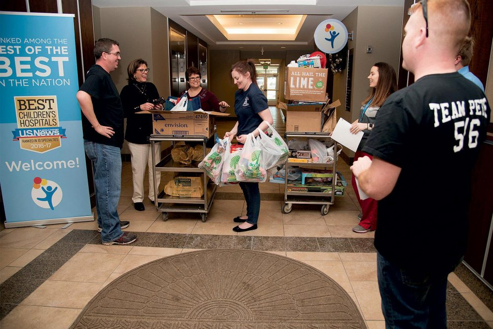 COLORADO SPRINGS, Colo. — Airmen from the 5/6 Club, Peterson Air Force Base, Colo., drop off toys at the Pediatric Center for Cancer and Blood Disorders at Children's Hospital Colorado, Dec. 19, 2016, in Colorado Springs, Colo. This year the 5/6 Club was able to collect approximately $3000 worth of toys from members of Team Pete and the U.S. Air Force Academy. The toys are used for holiday gifts and for use throughout the year while patients receive treatment.