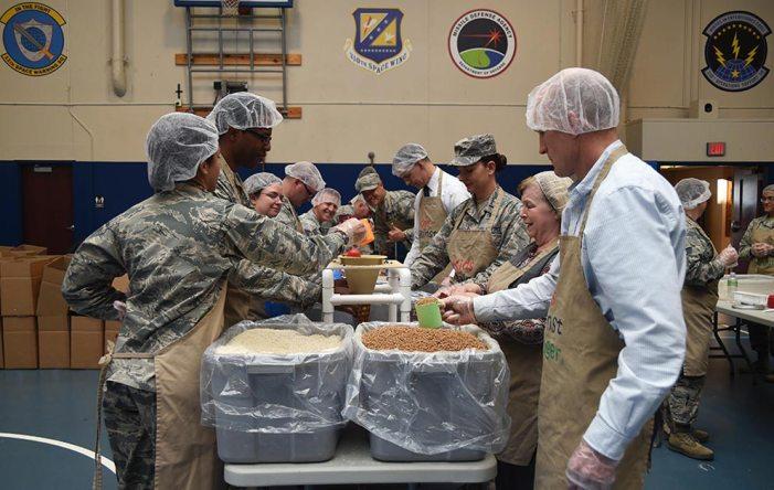AFSPC members provide Kids Against Hunger meals