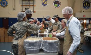 (Air Force photo/Senior Airman Arielle Vasquez) Airmen from Schriever Air Force Base, Peterson Air Force Base and Cheyenne Mountain Air Force Station prepare meals during a Kids Against Hunger volunteer event at Schriever Fitness Center, Tuesday, April 11, 2017. Volunteers prepared 40,000 meals, which will feed up to six people each.