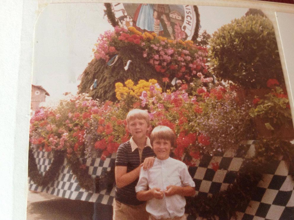 (Courtesy photo)  Matthew and James Hodges stand in front of a parade float in Garmisch-Partenkirchen, Germany in the early 1980s. While moving often is a challenge military children are faced with, moving can be a positive experience giving military children a chance to live all over the world.