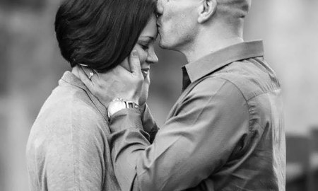 (Photo by Adam Harris) SAN LUIS OBISPO, Calif. – Senior Master Sgt. Jay Styles, Air Force Space Command Intelligence Reconnaissance and Surveillance command manager, kisses his wife Tech. Sgt. Jessica Styles, Air Force Space Command enlisted aide to the commander. Through the Join Spouse Program they've been stationed together since getting married almost 13 years ago.