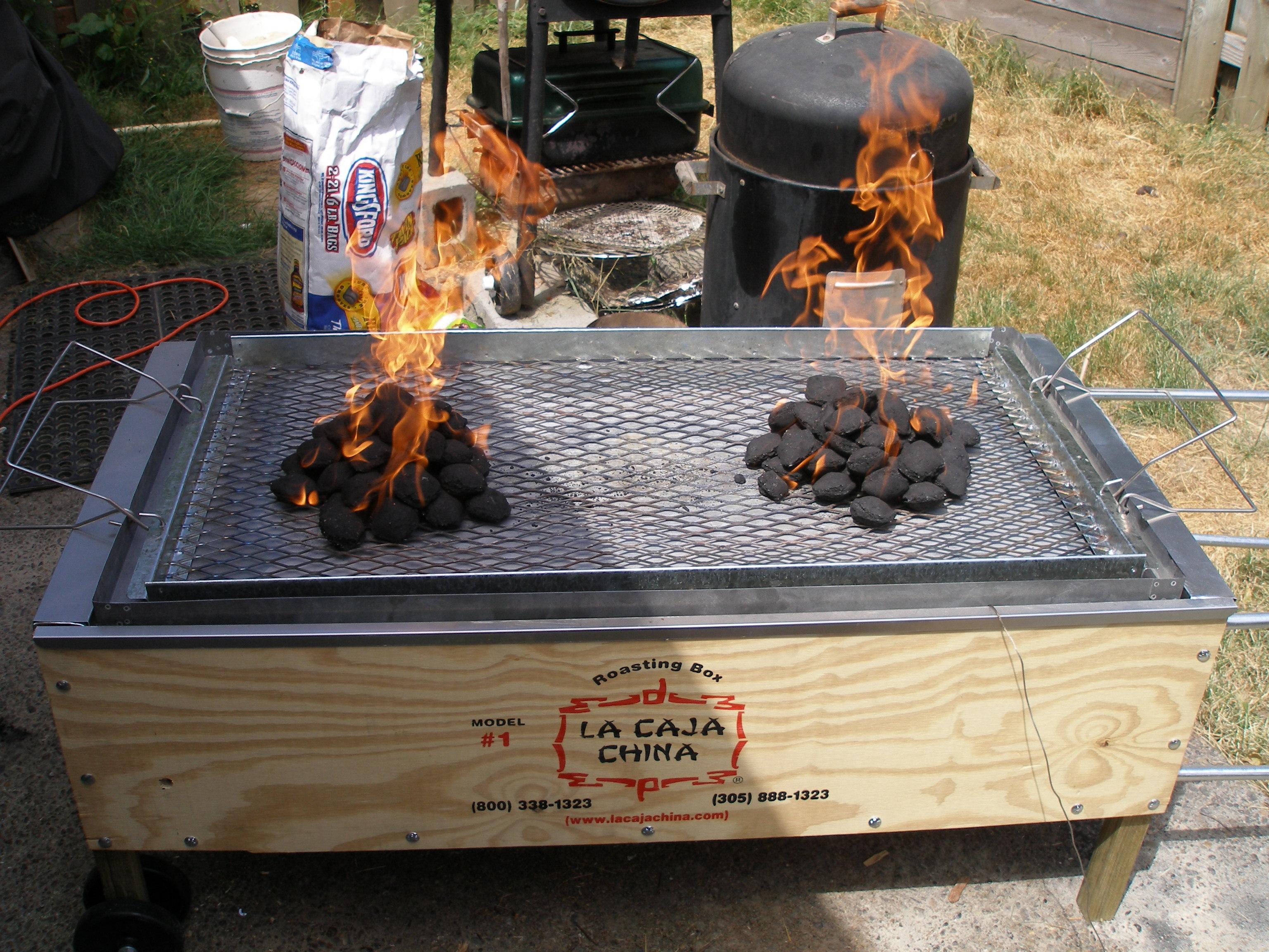 China Box Cooker ~ Beef ribs in la caja china cooking