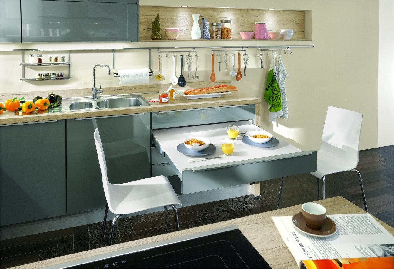 Cucina lineare con tavolo a scomparsa secret for Tufano arredamenti