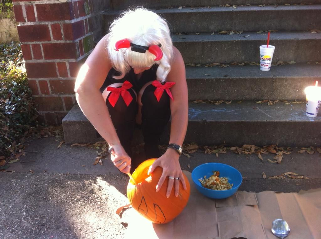 Scooping out the pumpkin seeds