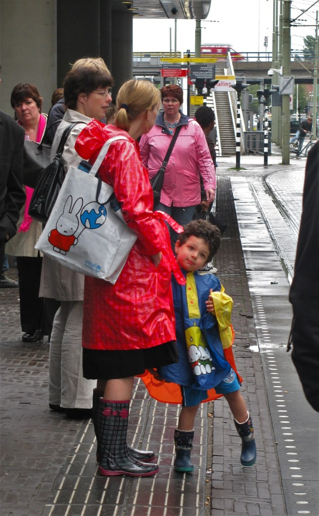Rain jackets and boots: Mother and son prepared for Dutch rainy weather