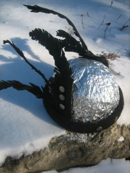 Sue's helmet : foil-covered stocking hat with felt feathers