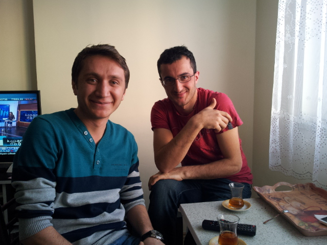 Mehmet and Ali Osman in Mehmet's apartment