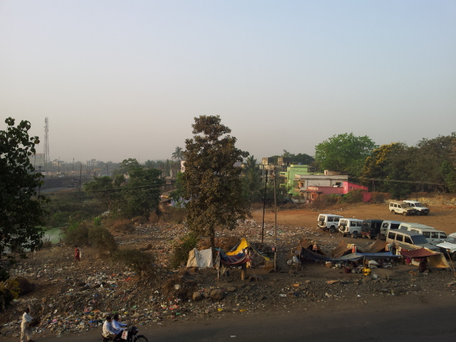 The morning scene from the Hotel in Shahapur; across the street families live in makeshift homes amongst the rubbish. Poverty is never far away.