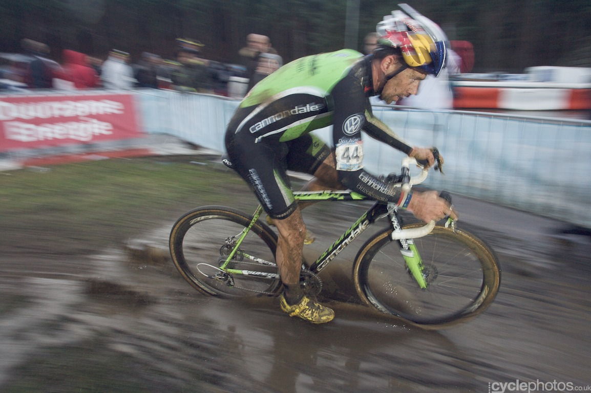 Tim Johnson cuts through a puddle