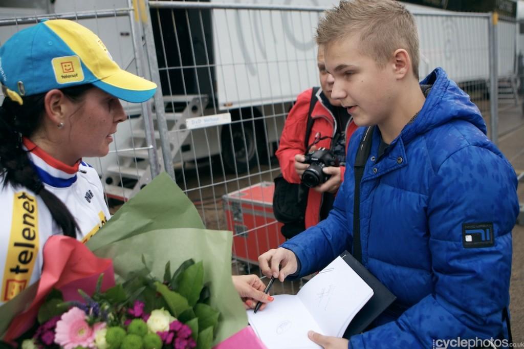 Nikki Harris gives an autograph