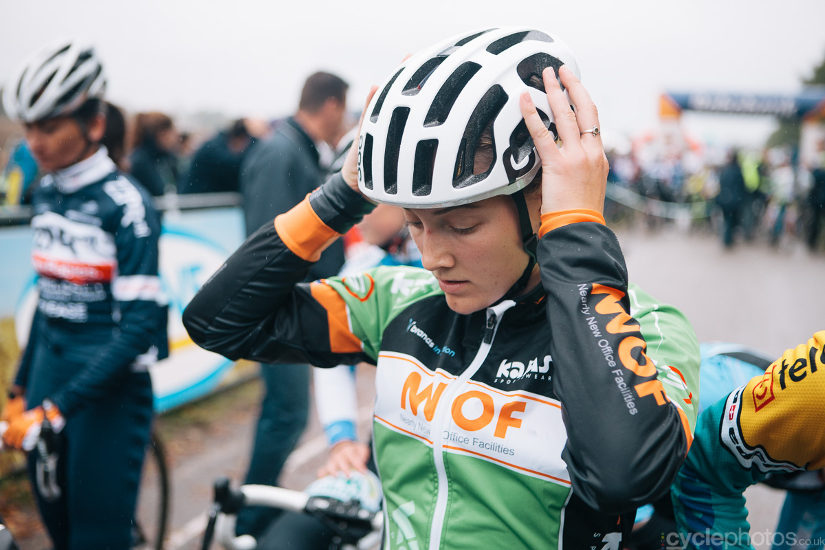 Elle Anderson puts on her helmet before the Superprestige cyclocross race in Gieten, in 2014. Photo by Balint Hamvas / cyclephotos.co.uk