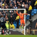 Tottenham Hotspur's goalkeeper Hugo Lloris can only watch as Navas's shot sails over him to put City in the lead after less than 30 seconds