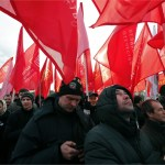 People hold red flags of the 'Great Fatherland party' during a rally in support of the Russian people of Crimea at the Marsovo field in St. Petersburg, Russia, 09 March 2014.