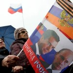 Pro-Russian supporters wave a Russian flag during a concert in the centre of Sevastopol, Crimea, Ukraine, 08 March 2014.