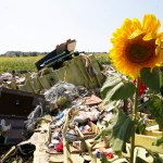 Ukraine says suspends attacks to let experts reach crash site