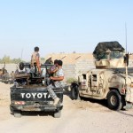 Iraqi security forces and Shi'ite volunteers patrol at Imam Wais village in Diyala province