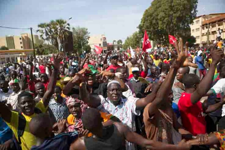 Protesters march on Burkina presidency after burning parliament