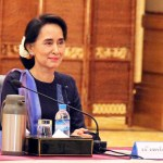 Myanmar opposition leader Aung San Suu Kyi smiles during a meeting at the presidential palace at Naypyitaw