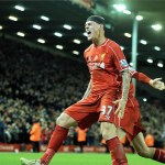 Martin Skrtel celebrates after heading in a late header from Steven Gerrard's corner to deny Arsenal.