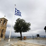 Cash-strapped Greece repays first part of IMF loan due in March