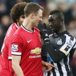 Bad boys: Jonny Evans and Papiss Cisse appeared to spit at each other at St James' Park during Man United's 1-0 win