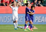 Japan into final after England injury-time own goal