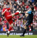Liverpool S Charlie Adam L Challenges Arsenal S Mas Rosicky R