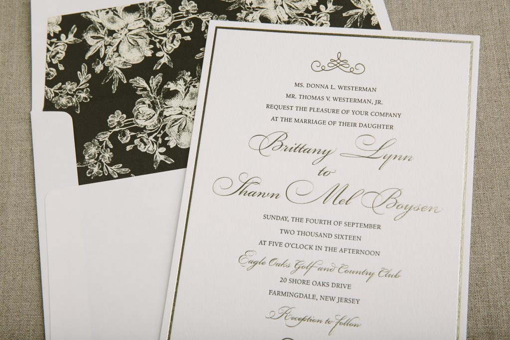 Formal wedding invitations in gold foil and classic black