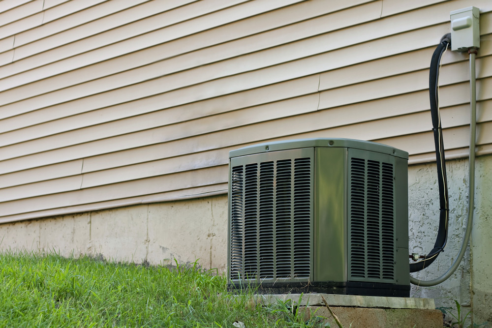 A Residential Central Air Conditioning Unit Sitting