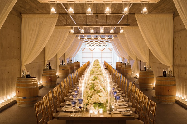 Alfresco Ceremony and Reception at Central California Vineyard - wedding reception setup with rectangular tables