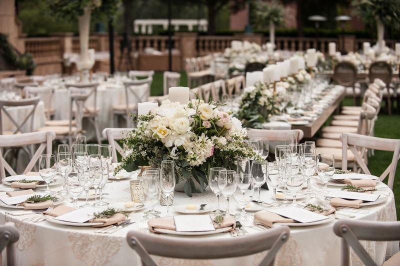 Reception Décor Photos - Low Arrangements of Cream Flowers - Inside - wedding reception round tables