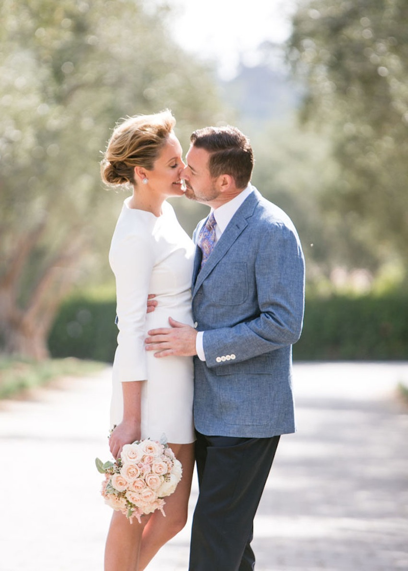 34 sleeve mini wedding dress mini wedding dress Bride in Carven long sleeve mini dress kisses groom
