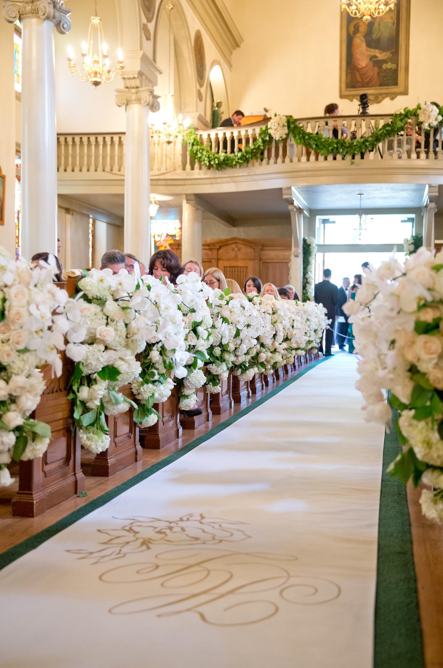 wedding aisle decorations Custom aisle runner and flowers at church wedding