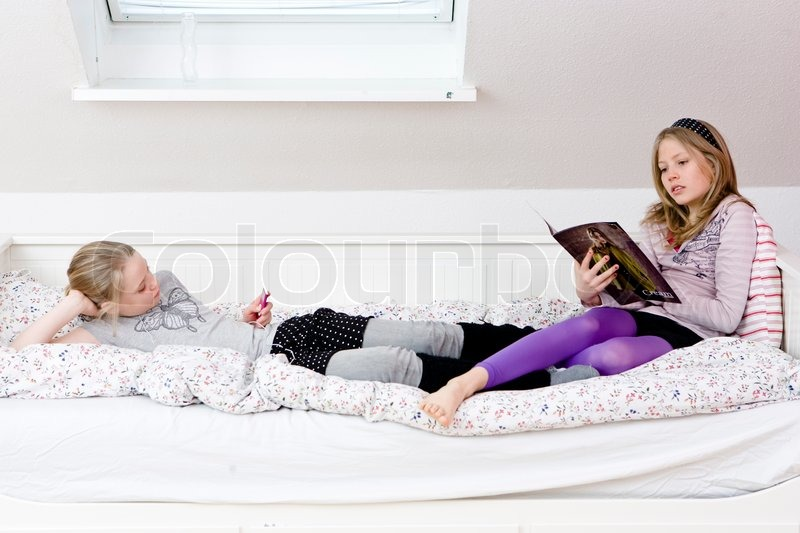 Best Teen Rooms Two Teenage Girls Hanging Out Inside Their Bedroom | Stock