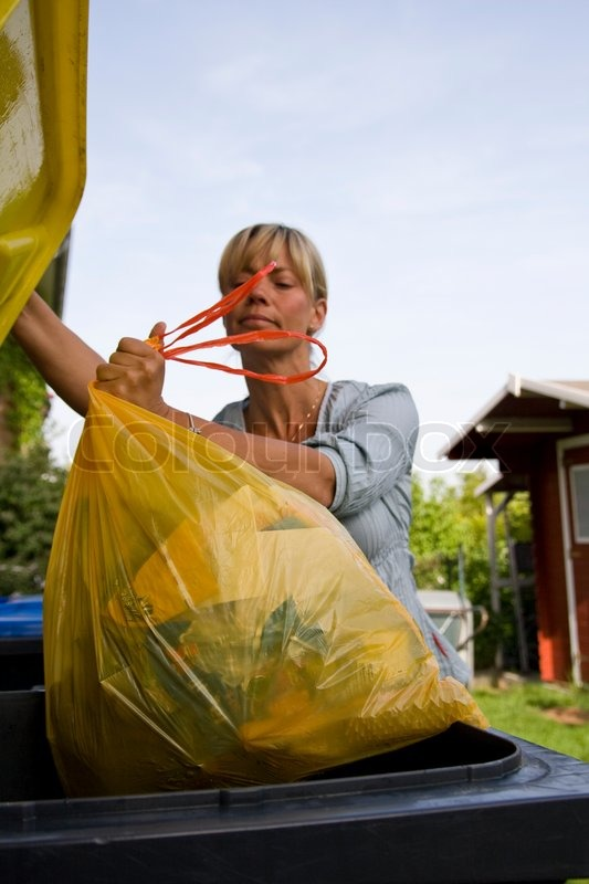 Images Stock Rubbish A Caucasian Woman Throwing Garbage In A Stock Photo