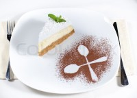 Decorative plating and presentation of a slice of creamy ...
