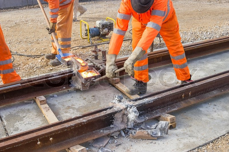 Tram track construction site, tracks being joinedThermite welding - thermite welding