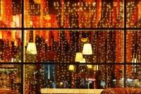 Christmas decorative lights of restaurant window in night ...