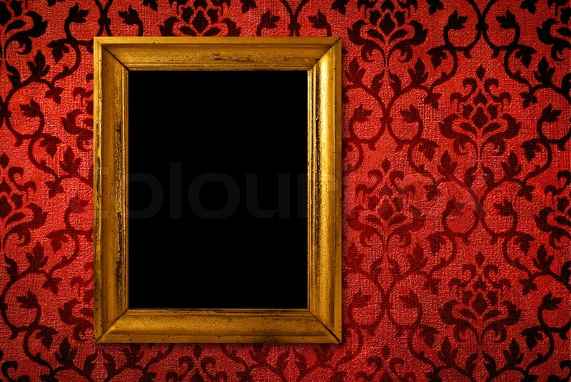 Gold frame on a vintage red wall Stock Photo Colourbox