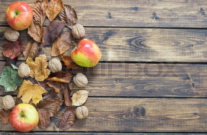 Dry Autumn Leaves Apples And Nuts Make A Left Border On
