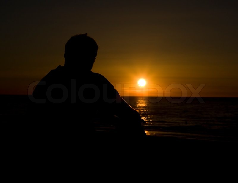 Lonely Girl Walking Wallpaper The Lonely Man Looks Beautiful Sunset Stock Photo