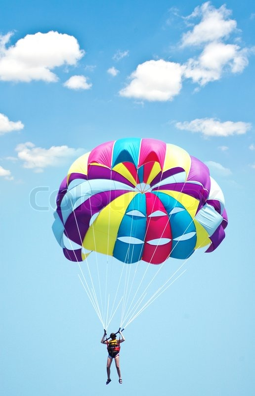 Paragliding Wallpaper Hd Multi Coloured Parachute Over The Blue Sky Stock Photo