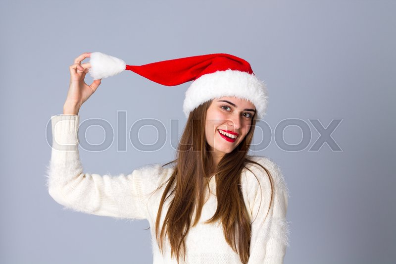 Young Smiling Woman In White Sweater Stock Photo