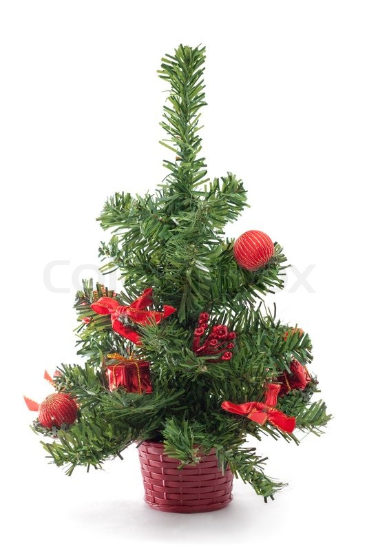 A small decorated Christmas tree on white background Stock Photo - small decorated christmas trees