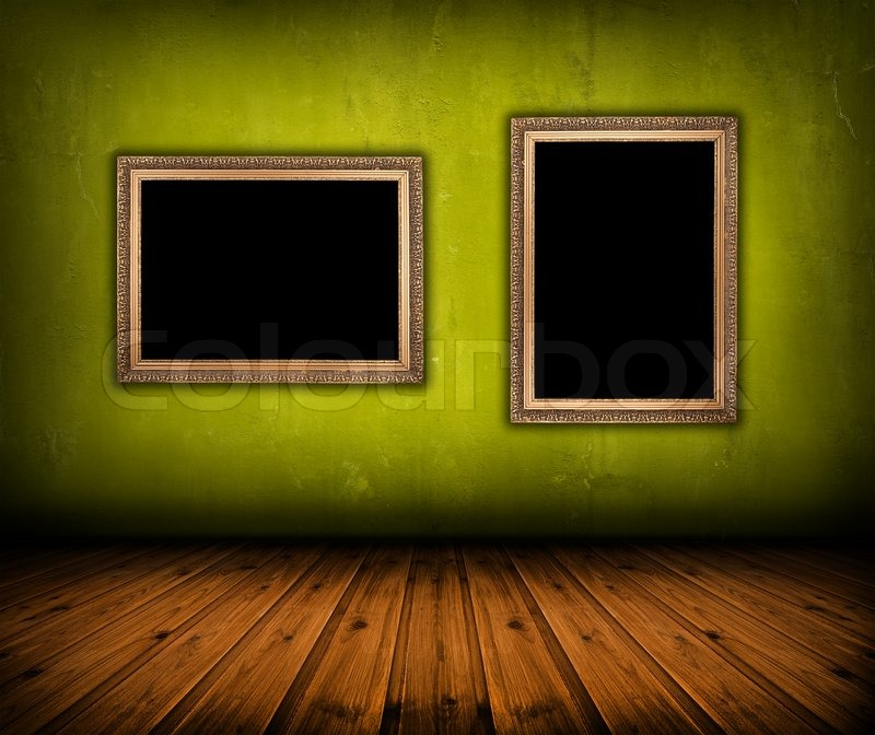 Vintage green interior with empty frame hanging on the wall Stock - green photo frame