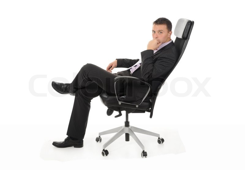 Businessman Sitting In A Chair In A Bright Office Isolated On White Background Stock Photo