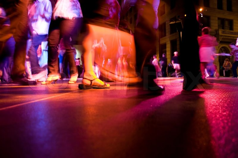 A Low Shot Of A Dance Floor With People Stock Photo