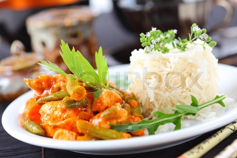 Red Chicken Curry Stripes With Rice And Vegetable Stock