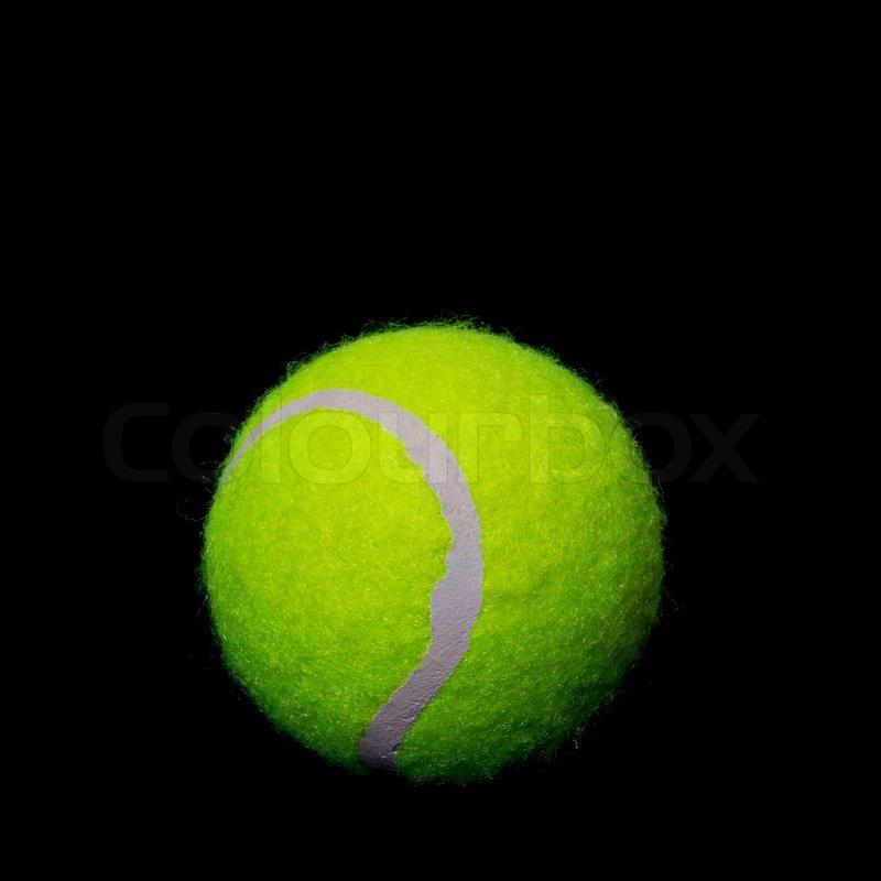 Tennis ball on a black background Stock Photo Colourbox