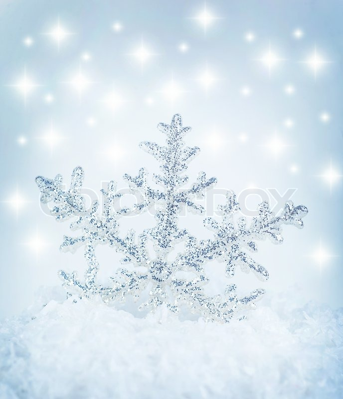 Beautiful blue snowflake winter holiday background Stock Photo